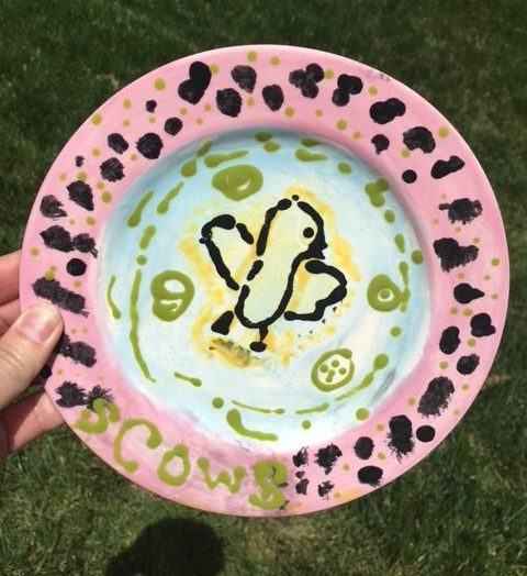 Ceramic plate of a chick hand-painted by a child