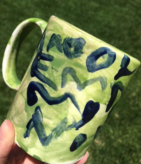 Ceramic coffee mug hand-painted by a child